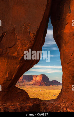 View of the Eagle Mesa through the Teardrop Arch in Monument Valley Navajo Tribal Park before sunset, Utah. - Stock Photo