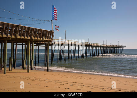 NC01190-00...NORTH CAROLINA - Flags flying on the Outer Banks Fishing Pier, located on the Atlantic Ocean in South - Stock Photo