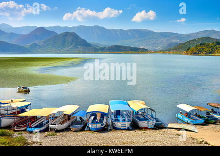 Excursion boats waiting for tourists, Skadar Lake, Montenegro - Stock Photo