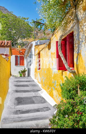 Colorful houses in Anafiotika quarter under the Acropolis, Athens, Greece - Stock Photo