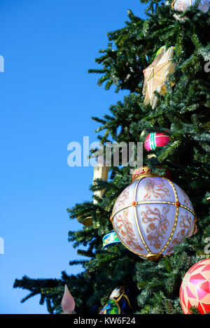 Christmas tree with large bauble baubles and star decorations. Evergreen. Space for copy - Stock Photo