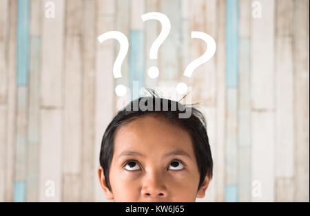 young asian boy looking to question mark. problem concept - Stock Photo