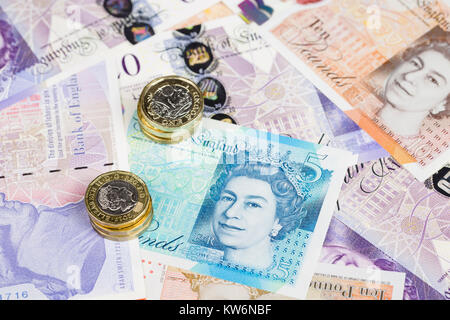 English banknotes and coins - Stock Photo