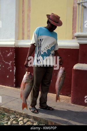 fisher men in Trinidad, Cuba - Stock Photo