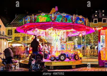 PFAFFENHOFEN, GERMANY - DEZEMBER 17: Illuminated merry-go-round at the christmas markted in Pfaffenhofen, Germany - Stock Photo