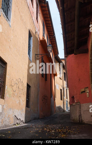 Alleyway in the shade in Sale Marasino, a small town near Lake Iseo, Italy - Stock Photo