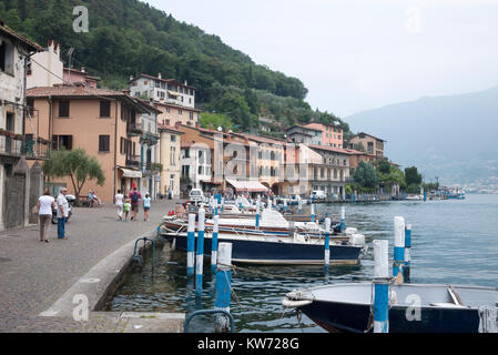 Boats moored on the jetty by Lake Iseo in Italy - Stock Photo