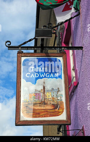 Hanging sign for the Public House, Tafan y Cadwgan, in Aberaeron, Ceredigion, Wales. - Stock Photo