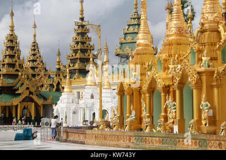 Near the base of Shwe Dagon pagoda in Yangon, Myanmar - Stock Photo