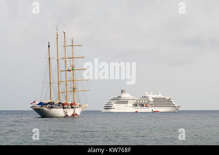 Star Clippers four masted barquentine and Seven Seas Navigator lying off Giardini Naxos, Sicily, Europe - Stock Photo