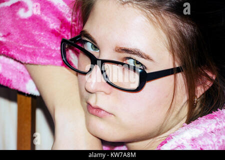 Portrait of a sad girl with glasses - Stock Photo