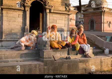 Sadhus holy men at Pashupatinath Temple in Kathmandu, Nepal - Stock Photo