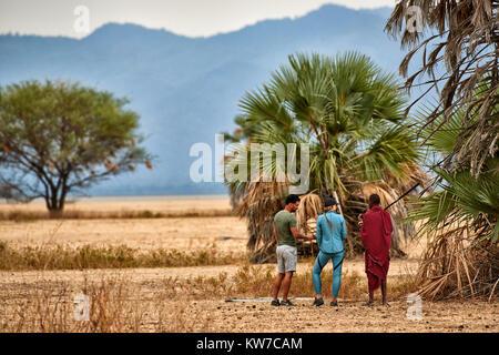 walking safari with Masai, Lake Manyara National Park, Tanzania, Africa - Stock Photo