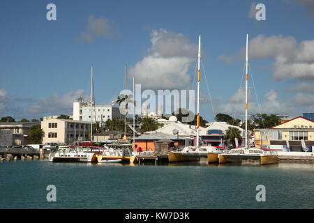 Port of St John's in the Caribbean island of Antigua, with the city & cathedral in the background. - Stock Photo
