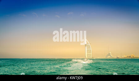 Jetskis near Dubai coast with Burj Al Arab and Jumeirah Beach hotels in the backdrop - Stock Photo