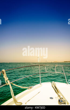 View of Dubai coast from the bow of a yacht - Stock Photo