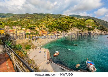 The sandy beach Spiaggia di Fegina at the old side of the Cinque Terre Italy resort village of Monterosso al Mare - Stock Photo