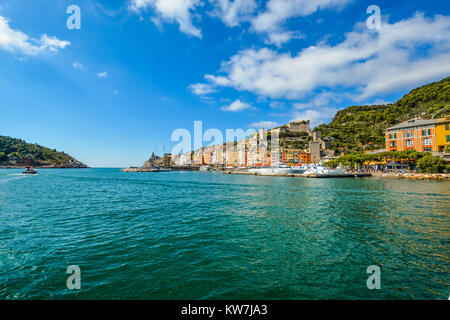 The colorful village of Porto Venere on the Ligurian Coast of Italy with the Church of St Peter and Castello Doria - Stock Photo