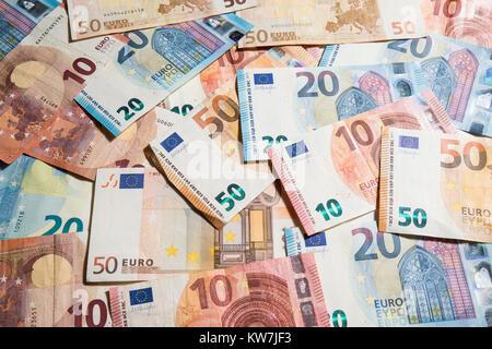 Overhead view of 10, 20 & 50 value Euro notes, randomly arranged - Stock Photo
