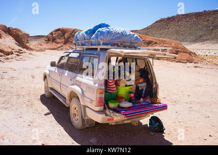 Huayllajc, Bolivia - August 26, 2015: 4x4 vehicle taking tourists on the desertic highlands of the Andes in Huayllajc, - Stock Photo