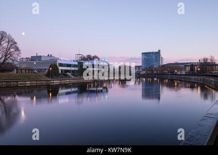 View of Tartu city over the Emajogi river after sunset. Tartu, Estonia. - Stock Photo