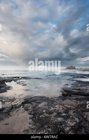 Bamburgh Castle in the late evening sunlight at sunset - Stock Photo