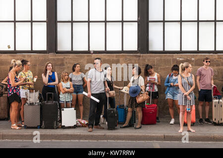 people waiting in line at a bus stop, Florence, Italy - Stock Photo