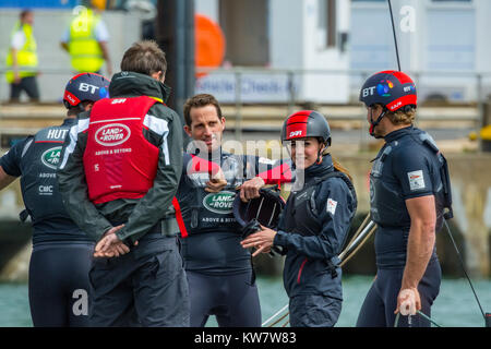 The Duchess of Cambridge smiles for the camera whilst talking to Sir Ben Ainslie and his colleagues during a visit - Stock Photo
