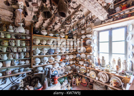 Vintage pottery collection and exhibition in the Ettore Guatelli Museum, Parma, Italy; arranged on shelves as in - Stock Photo