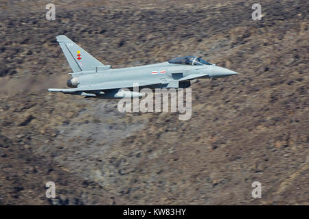 British Royal Air Force Eurofighter Typhoon FGR4 Jet Fighter Flying At Low Level And High Speed Through Rainbow - Stock Photo