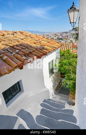Traditional white wall houses in the Anafiotika quarter under the Acropolis, Athens, Greece - Stock Photo