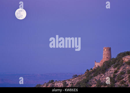 full moon over the watchtower at desert view above grand canyon national park, arizona - Stock Photo