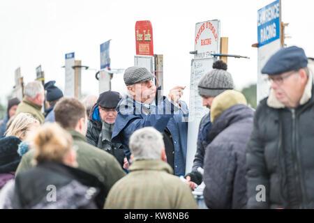 Cambridgeshire, UK. 31st December, 2017. Cottenham, Cambridgeshire UK 31st December 2017.   A bookie writes the - Stock Photo