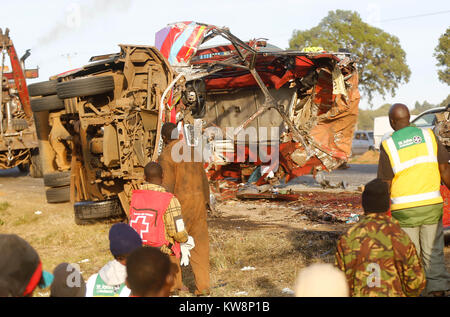 Nairobi. 31st Dec, 2017. People gather around the site where a road accident occurred on the Nakuru-Eldoret highway - Stock Photo