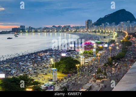 Rio de Janeiro, Brazil - Dec 31st, 2017: Aerial view of Copacabana beach at night as party-goers wait for the iconic - Stock Photo