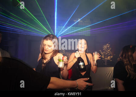 London, UK. 31st Dec, 2017. Party goers celebrating the arrival of the new year at a Lost in Disco club night at - Stock Photo