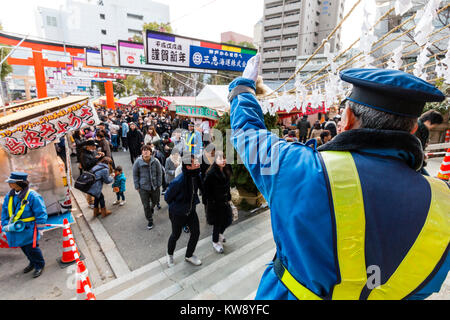 Japan, Kobe, Ikuta shrine. New year celebrations, crowds going to the shrine for their Hatsumode, the important - Stock Photo