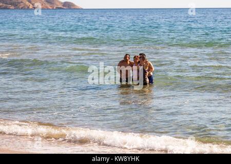 Poniente Beach, Benidorm, Costa Blanca, Spain, 01 January 2018. Tourists and locals flock to the beach in Benidorm, - Stock Photo