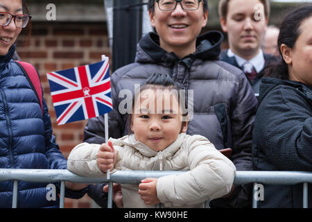 London, UK. 1st Jan, 2018. A young fan of the parade waves her Union Jack flag in anticipation. Performers, bands - Stock Photo