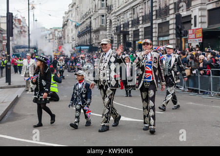 London, UK. 1st Jan, 2018. The Pearly Kings and Queens on Picadilly. Performers, bands and other participants entertain - Stock Photo