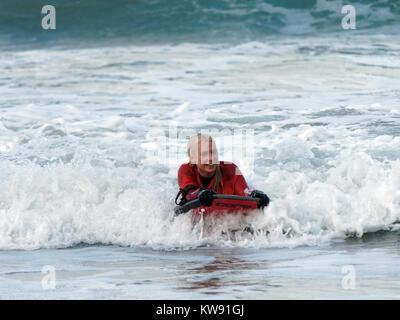 Newquay, UK. 01st Jan, 2018. UK weather New year brave revellers at Towan Beach. 1st January, 2018 Credit: Robert - Stock Photo