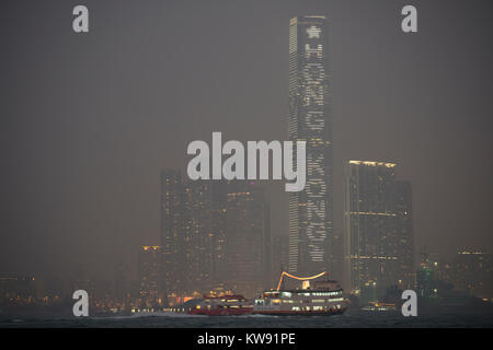 Hong Kong, 1st January, 2018. Heavy pollution and haze covers the skyline on New Years Day 2018. Credit: Bob Henry/Alamy - Stock Photo