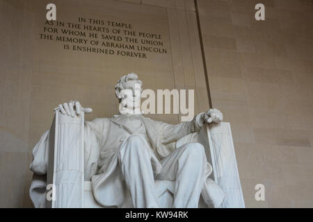 Close up interior shot of marble statue of Abraham Lincoln sitting contemplating in the Lincoln Memorial, Washington - Stock Photo