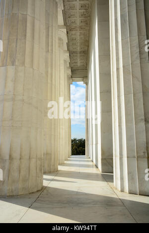 Close up interior exterior shot of marble Doric columns and colonnade in the Lincoln Memorial, Washington DC, USA - Stock Photo