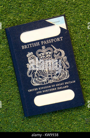 Expired British Passport with Blue Cover - Stock Photo