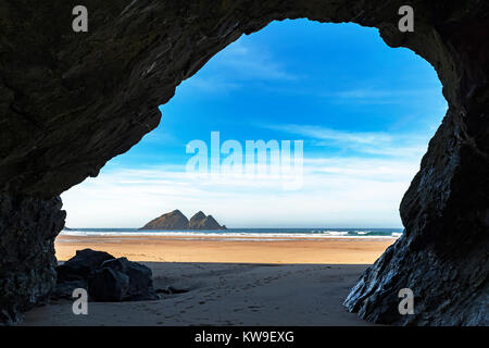 carters rocks aka gull rocks, photo taken from inside a cliff cave on the beach at holywell bay, cornwall, uk. - Stock Photo
