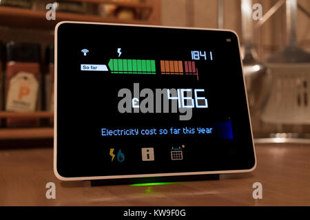 chameleon technology smart meter, the display shows the cost of energy being used in a home. - Stock Photo