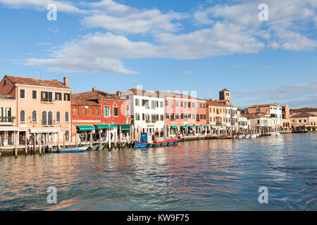 Murano Island, Venice, Italy, view along Riva Longa on a sunny winter day with tourists shoppig for Murano glass - Stock Photo
