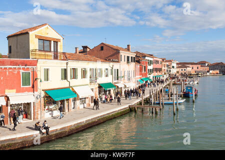 Murano Island, Venice, Italy, elevated view along Riva Longa on a sunny winter day from Ponte Longo with crowds - Stock Photo