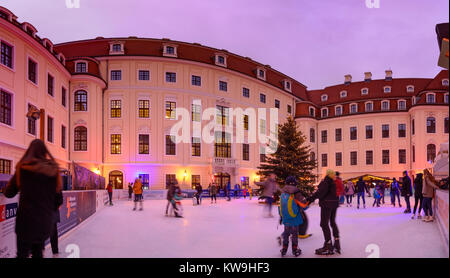 patio of hotel taschenbergpalais kempinski ice rink ice skater christmas decoration